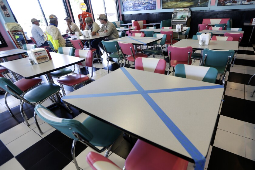 Tables are marked off for social distancing at Hwy 55 Burgers Shakes & Fries in Nolensville, Tenn.
