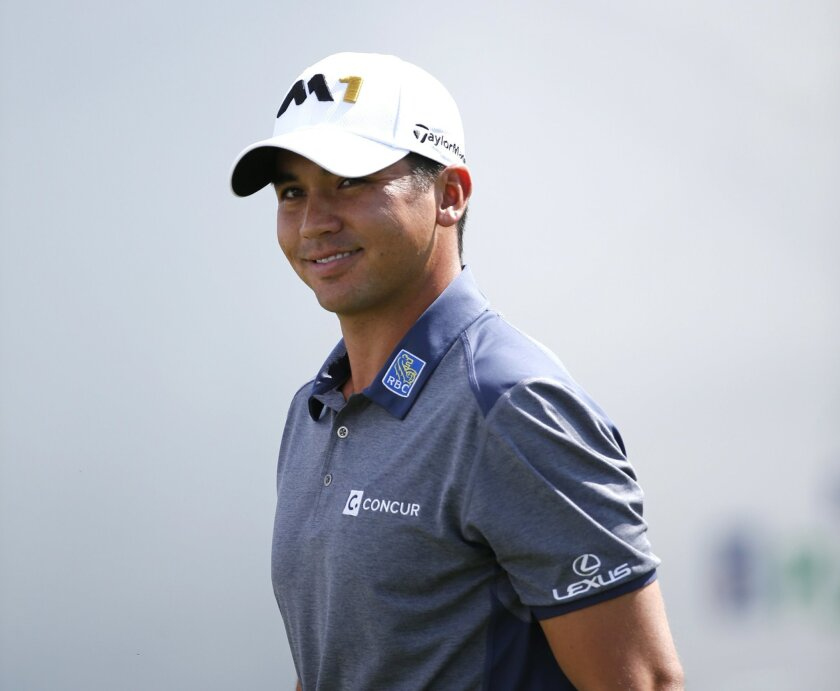 Jason Day, of Australia, smiles as he heads to the first hole during the final round of the BMW Championship golf tournament at Conway Farms Golf Club, Sunday, Sept. 20, 2015, in Lake Forest, Ill. (AP Photo/Charles Rex Arbogast)