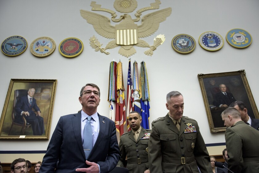 Defense Secretary Ashton Carter and Chairman of the Joint Chiefs of Staff Gen. Joseph Dunford arrive for a hearing of the House Armed Services Committee on Dec. 1.