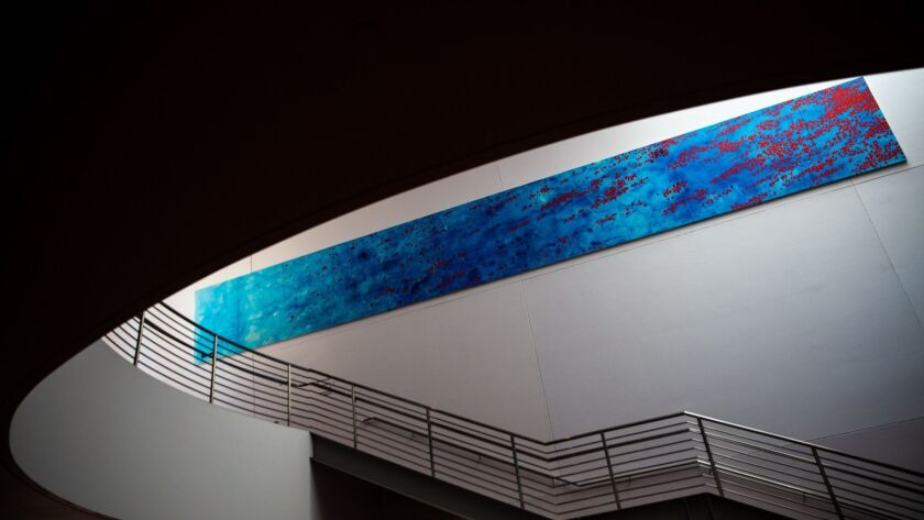 "Peter Alexander's ""Blue"" hangs on a wall inside the Walt Disney Con"