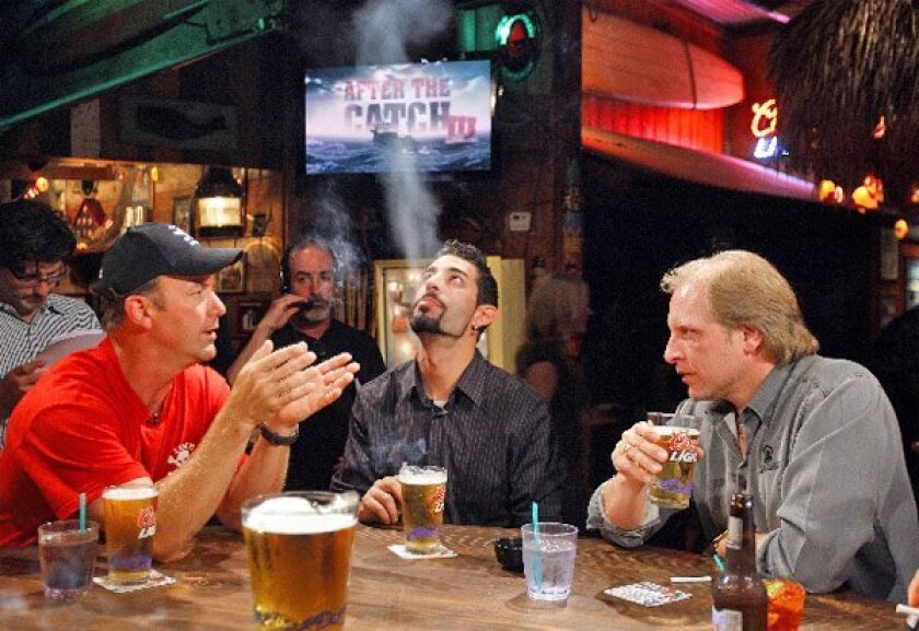 """""""Deadliest Catch"""" crews taped end-of-the-season episodes at RT's Longboard Grill, which was rented by Discovery Channel and closed to the public. Taking a break  were (from left) Andy Hillstrand, Josh Harris and  Sig Hansen. (K.C. Alfred / Union-Tribune)"""