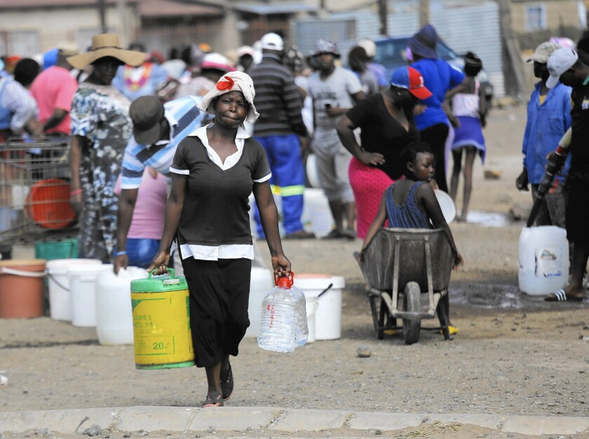 Residents wait in line at a water distribution point in Senekal, South Africa.