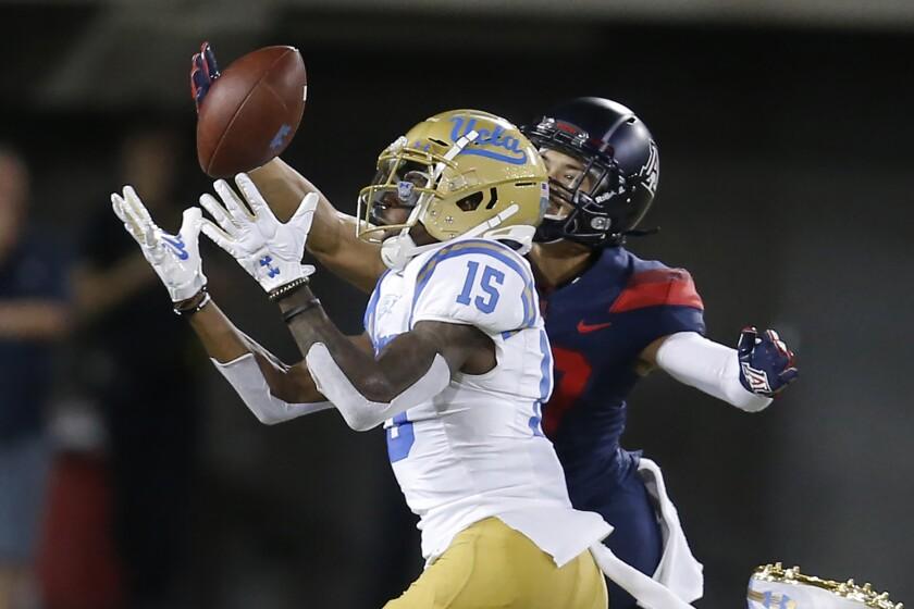 Arizona cornerback Jace Whittaker knocks the ball away from UCLA wide receiver Jaylen Erwin.