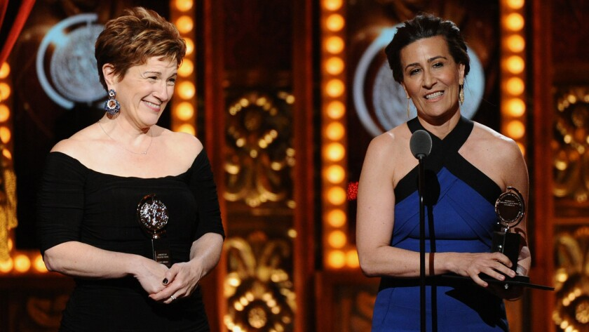 "Lisa Kron, left, and Jeanine Tesori accept the award for best score for ""Fun Home"" during the 69th Tony Awards at New York's Radio City Music Hall on Sunday."