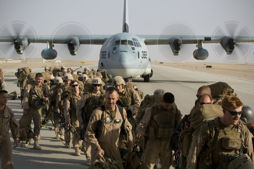 At Bastion Airfield in Helmand Province, some of the last Marines left on Camp Leatherneck earlier handed over their guard post to their Afghan National Army counterparts and now board C-130 for the official withdrawal of U.S. Marines from Helmand Province.