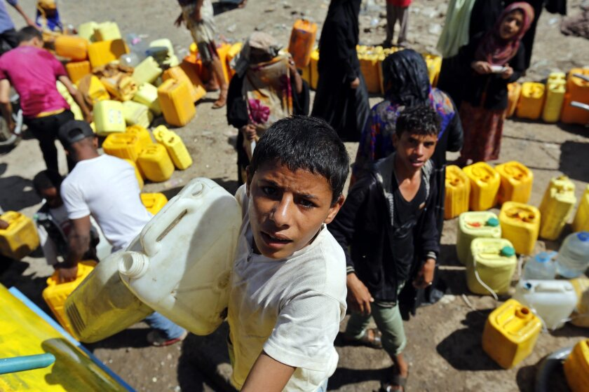 Amid widespread disruption of water supplies, Yemenis wait to fill containers with donated water in Sana on Aug. 21.