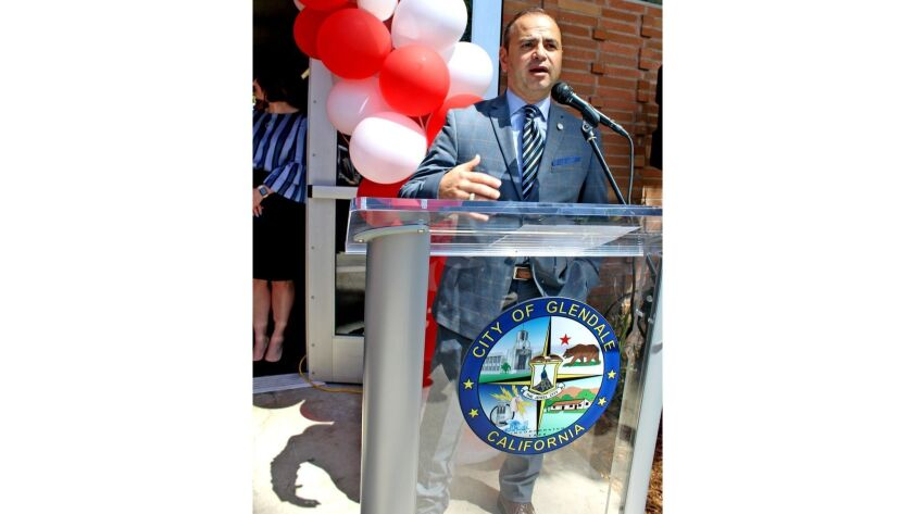 Surrounded by celebratory balloons, Glendale Mayor Zareh Sinanyan speaks at Grandview Library's re
