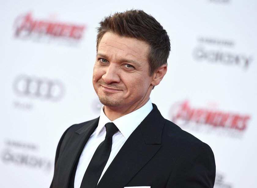 """FILE - In this April 13, 2015 file photo, Jeremy Renner arrives at the Los Angeles premiere of """"Avengers: Age Of Ultron."""" Renner and Chris Evans have apologized for what they called their """"tasteless"""" joking about the sole female Avenger, Scarlett Johansson's Black Widow. The actors both issued apologies Thursday after teasing the """"Avengers: Age of Ultron"""" character with derogatory slurs. (Photo by Jordan Strauss/Invision/AP, File)"""