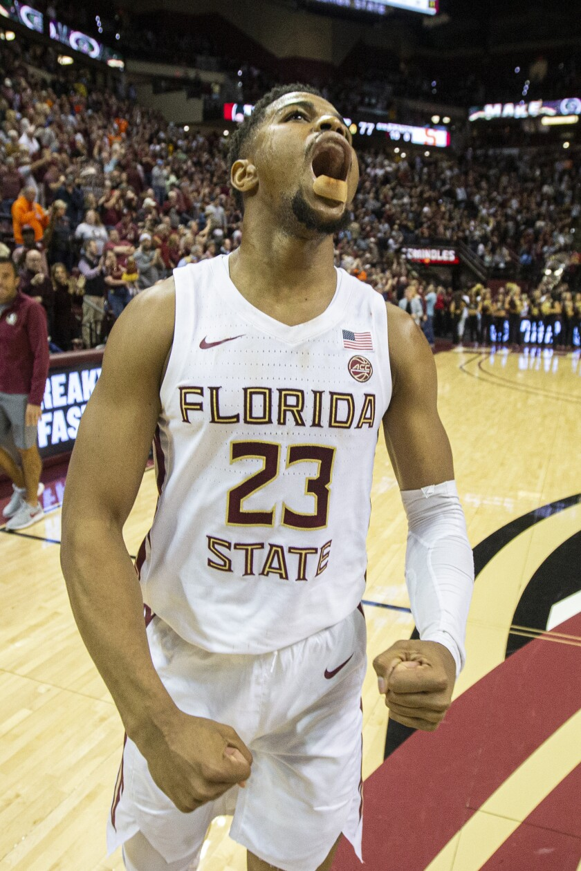 Florida State guard M.J. Walker (23), With a bandage covering the stitches in his lip from the first half, reacts after defeating Syracuse in NCAA college basketball game in Tallahassee, Fla., Saturday, Feb. 15, 2020. Florida State won 80-77. (AP Photo/Mark Wallheiser)