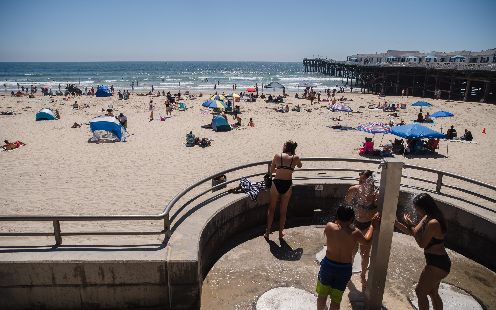 Beachgoers wash off on July 5 in Pacific Beach.