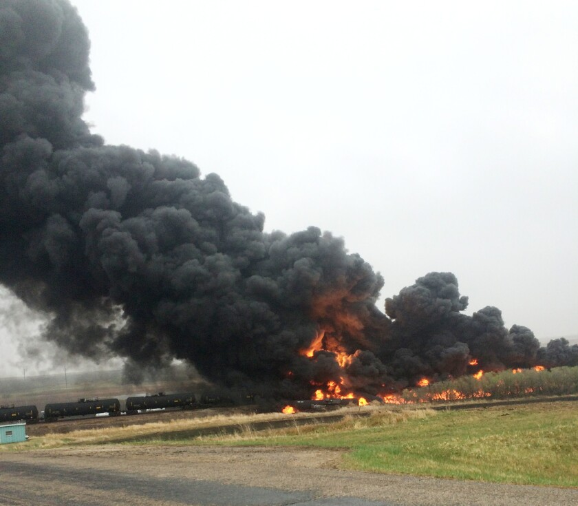 Smoke and flames rise from an oil train that derailed in North Dakota.