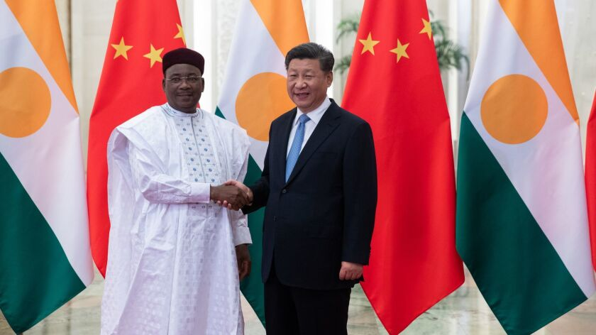 Chinese President Xi Jinping, right, and Mahamadou Issoufou, the president of Niger, meet in Beijing on Aug. 31. Issoufou is in China for the Forum on China-Africa Cooperation, starting Monday.