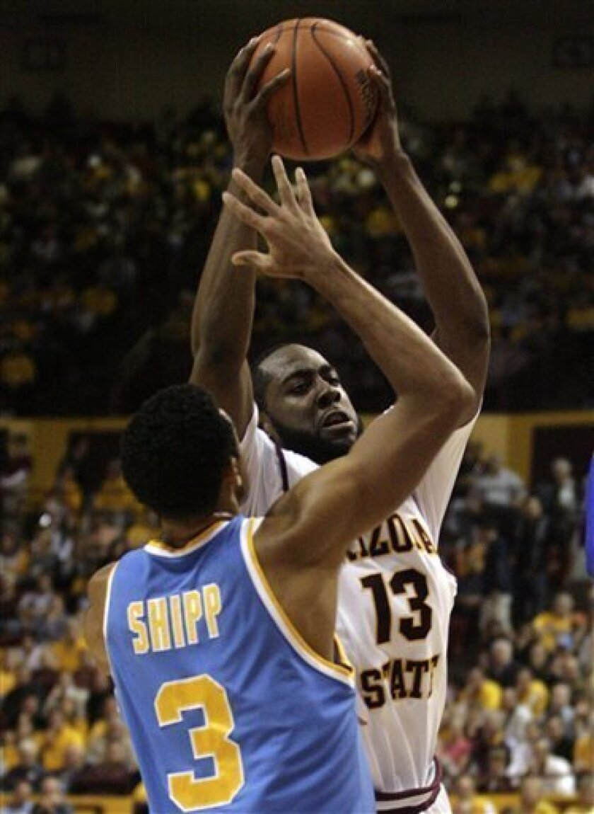 Arizona State guard James Harden (13) attempts to drive to the basket as he is guarded by UCLA guard Josh Shipp (3) in the first half of an NCAA basketball game Thursday, Feb 12, 2009, in Tempe, Ariz. (AP Photo/Paul Connors)