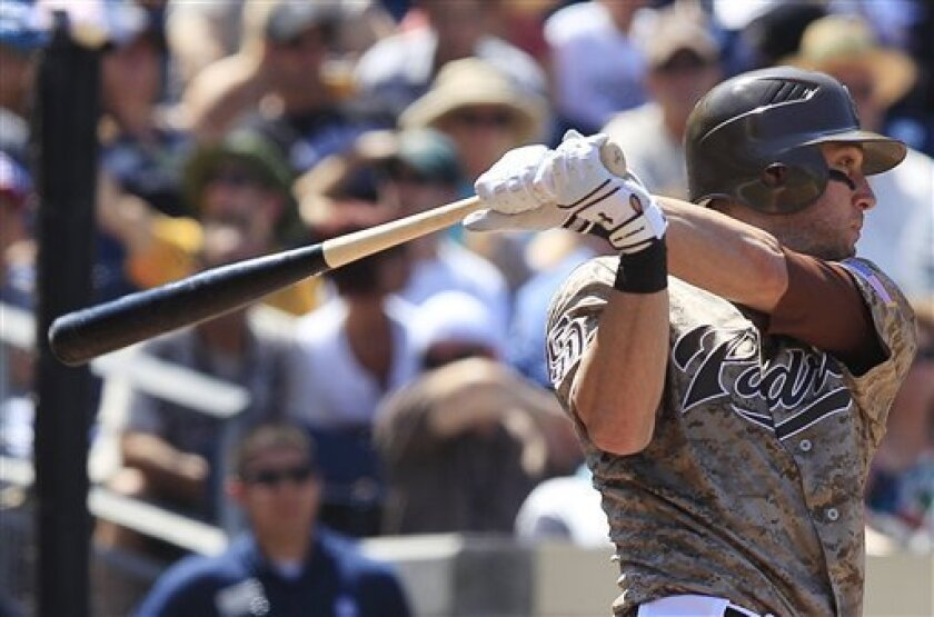 San Diego Padres' Jeremy Hermida watches his second run producing hit of the game against the Colorado Rockies in the third inning of a baseball game Sunday, Sept. 4, 2011 in San Diego. This hit brought in two runs. (AP Photo/Lenny Ignelzi)