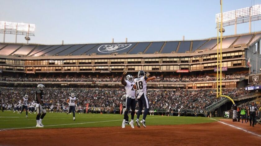 Rookie receiver Cooper Kupp celebrates in the end zone after scoring his second touchdown of the pre