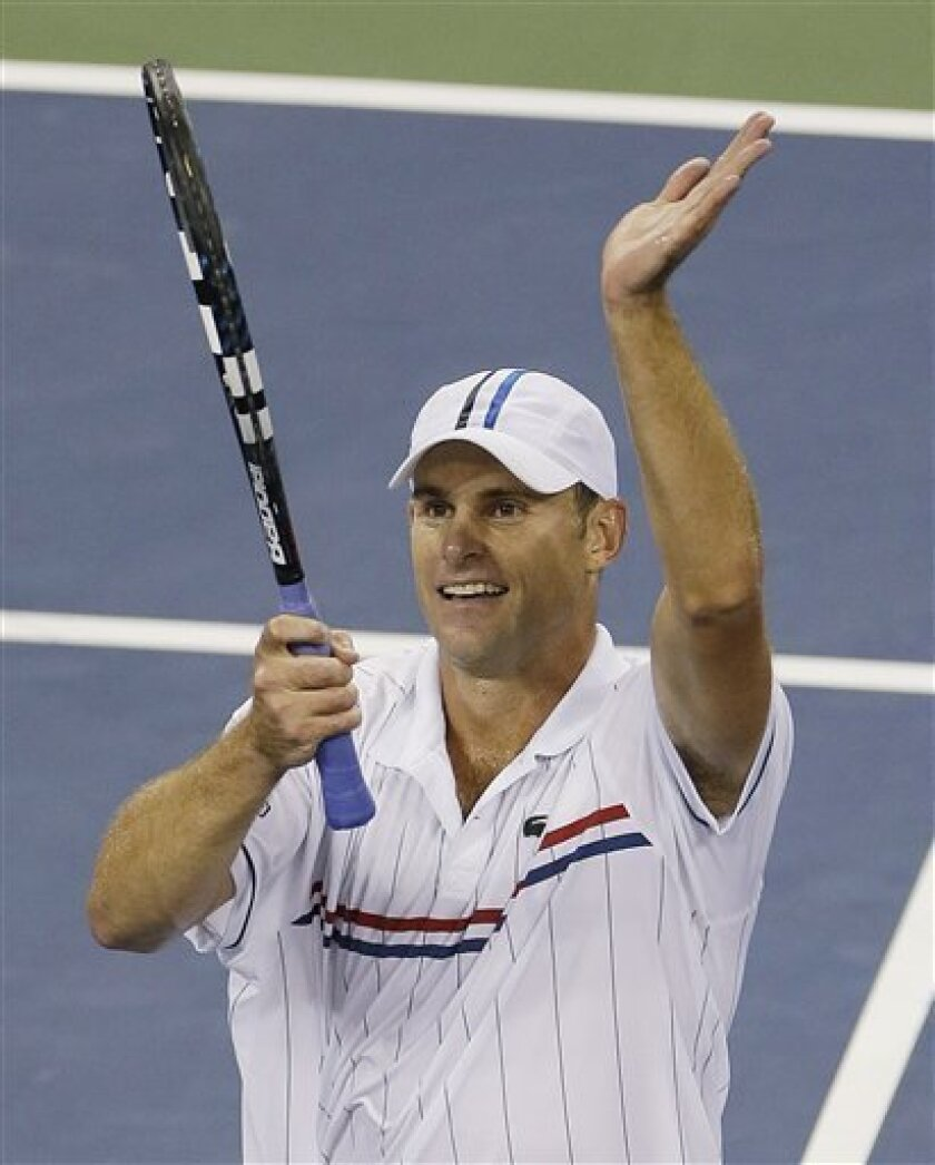Andy Roddick reacts after winning his match against Australia's Bernard Tomic in the third round of play at the 2012 US Open tennis tournament,  Friday, Aug. 31, 2012, in New York. (AP Photo/Mike Groll)