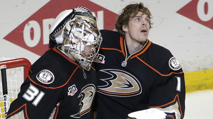 Ducks goalies Frederik Andersen, left, and Jonas Hiller celebrate their victory over the Dallas Stars in Game 3 of the Western Conference quarterfinals. Which netminder will be in the crease for the start of the Ducks' second-round playoff series?