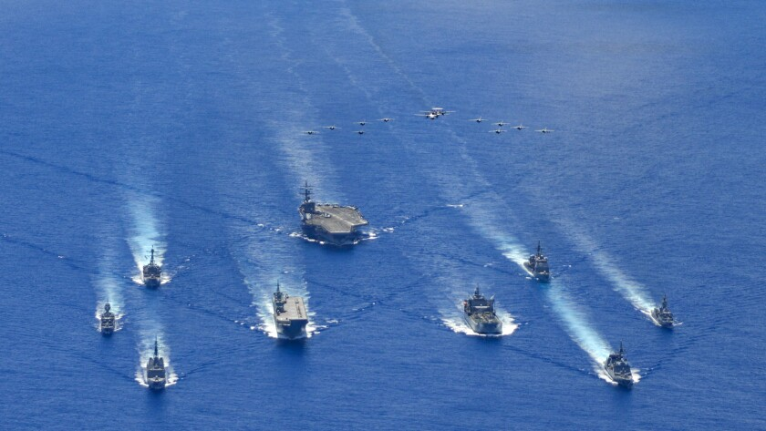 Australian, U.S. and Japanese naval ships take part in a trilateral exercise July 21 in the Philippine Sea.