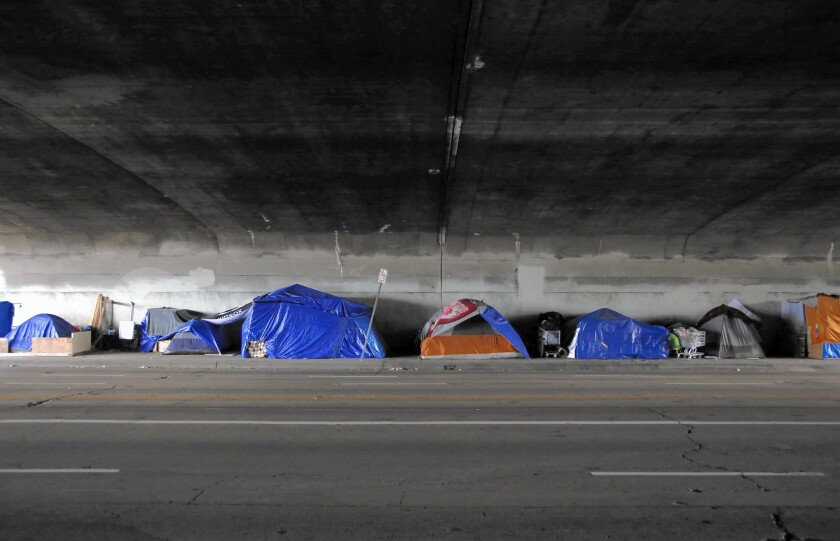 A tent encampment, beneath an overpass, on Alvarado Street near Echo Park.