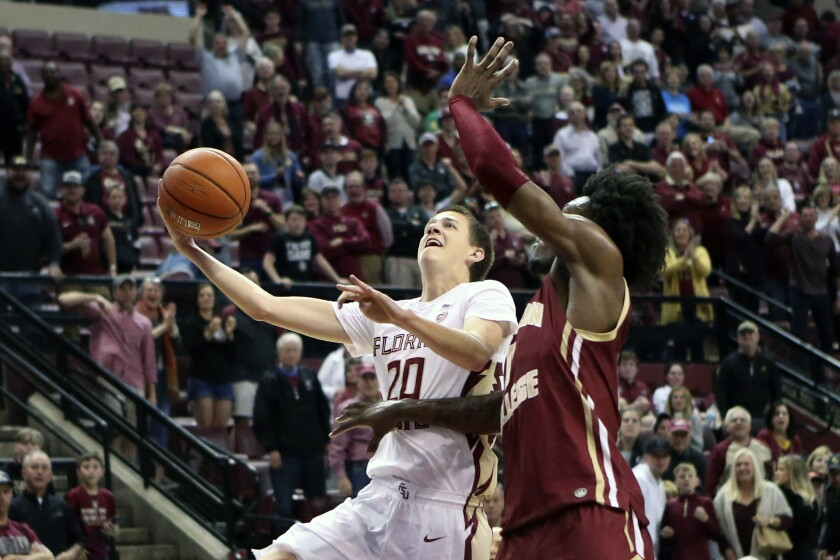 Florida State's Travis Light, left, drives around Boston College's CJ Felder as he attempts to score in the second half of an NCAA college basketball game Saturday, March 7 2020, in Tallahassee, Fla. Florida State won 80-62. (AP Photo/Steve Cannon)