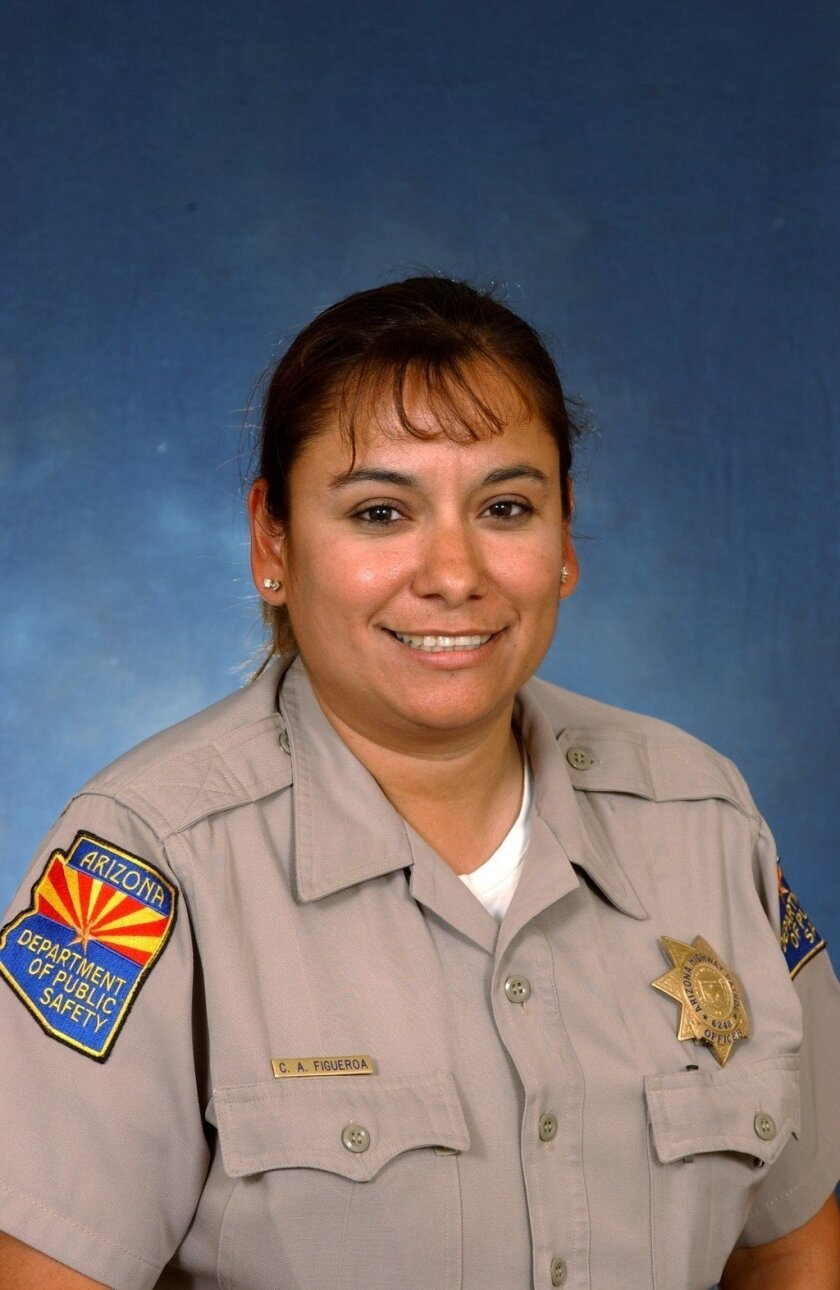 This undated photo provided by the Arizona Department of Public Safety shows Arizona's state police agency detective Carmen Figueroa. Figueroa recently resigned from her post following the discovery that she was in the United States illegally after being brought from Mexico at a young age, the agency said Wednesday, Dec. 11, 2013. Figueroa, apparently was told by her family that she was born in the United States, though she was actually born in Sinoloa, Mexico, Department of Public Safety spokesman Bart Graves said. Figueroa worked for DPS in southern Arizona and was with the department for 10 years. (AP Photo/Arizona Department of Public Safety)