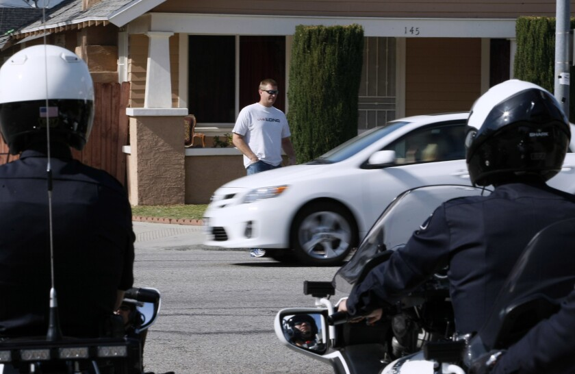 Glendale motorcycle officers conduct a pedestrian safety operation involving an undercover officer crossing the road near Hawthorne Street and Pacific Avenue in this photo from January 2014.