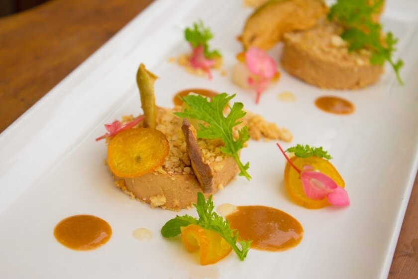 The Patio on Goldfinch is serving a foie gras torchon with candied kumquats, Anjou pears, Marcona almond crumble and mustard frill.