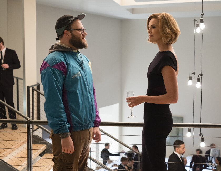 """This image released by Lionsgate shows Seth Rogen, left, and Charlize Theron in a scene from """"Long S"""