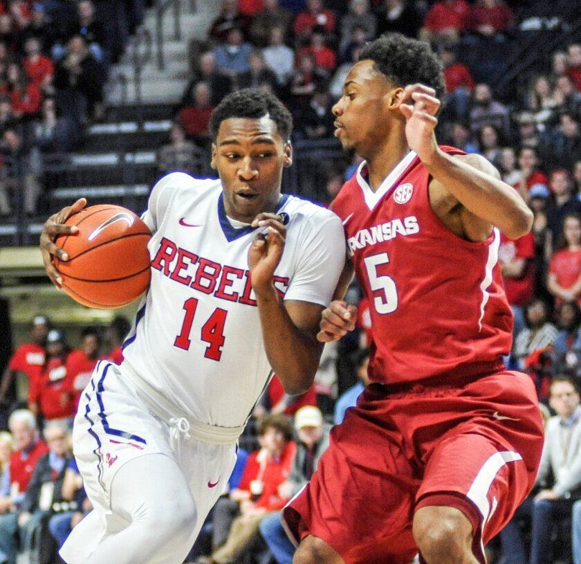 Mississippi guard Rasheed Brooks (14) drives the lane against Arkansas Razorbacks guard Anthlon Bell (5) during an NCAA college basketball game on Saturday, Feb. 13, 2016, in Oxford, Miss. (Bruce Newman /The Oxford Eagle via AP)  NO SALES; MANDATORY CREDIT