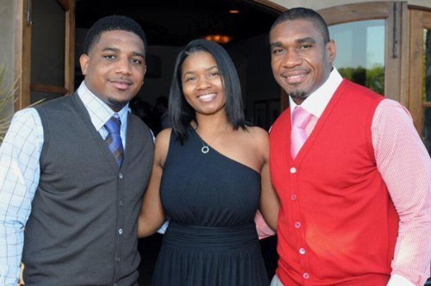 Quentin Jammer (right) with brother Quandre Diggs and cousin Kowanza Albro