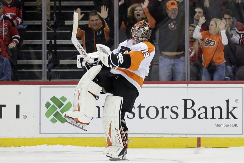 FILE - Philadelphia Flyers goaltender Carter Hart reacts after New Jersey Devils' Taylor Hall missed the last shot of a shootout in an NHL hockey game in Newark, N.J., in this Friday, Nov. 1, 2019, file photo. The Flyers won 4-3. The Flyers are counting on 22-year-old goalie Carter Hart to lead them to the title. (AP Photo/Seth Wenig, File)