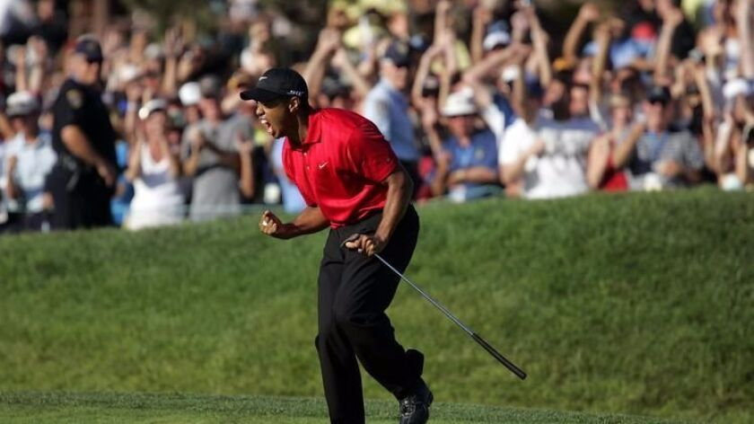Tiger Woods celebrates his birdie putt on the final hole in the fourth round of the U.S. Open at Torrey Pines.