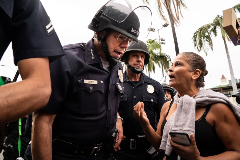 LAPD Chief of Police Michel Moore speaks with a protester in the Fairfax District.