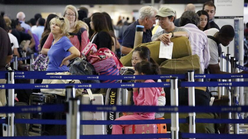 Passengers wait to check in for Labor Day weekend travel on Aug. 30, 2013, at Los Angeles International Airport. LAX is expected to see a record number of travelers for the 2018 Labor Day weekend.