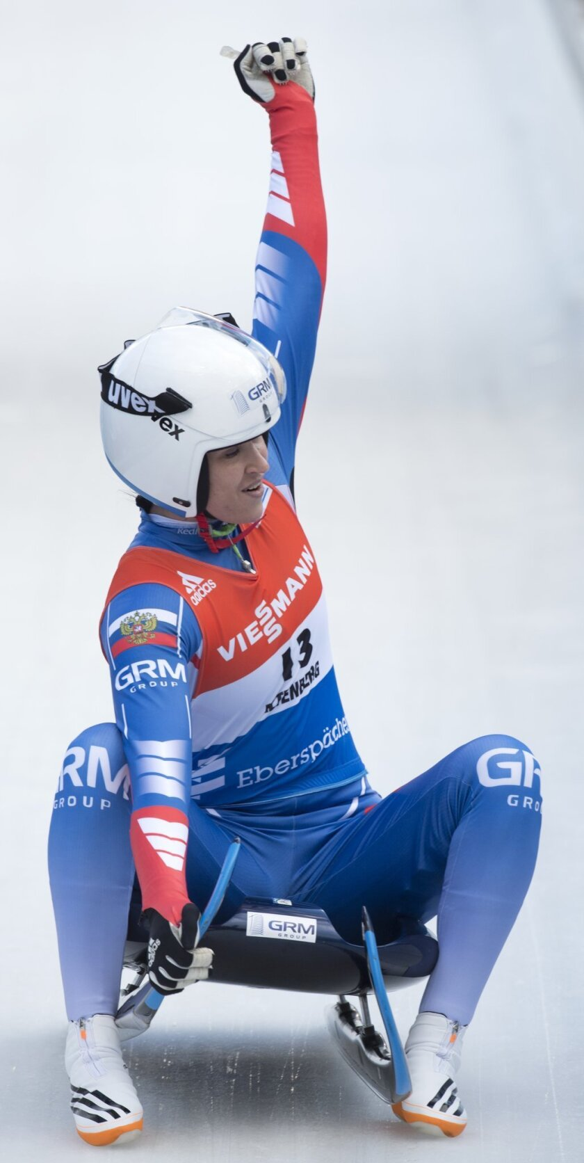 Tatiana Ivanova of Russia celebrates her third place  after the women's  World Cup  luge race in Altenberg, eastern Germany, Sunday, Feb. 14, 2016. (AP Photo/Jens Meyer)