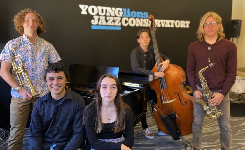 Musicians, from left, Benjamin Delgado, Elijah Marrewa, Brenda Greggio, John Murray and Nick Caldwell won a top music award.