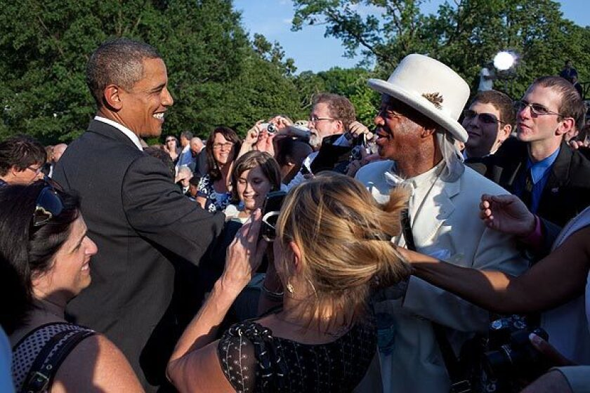 President Obama shakes hands with Nathaniel Ayers at an event commemorating the 20th anniversary of the Americans with Disabilities Act on the South Lawn of the White House in 2010. See full story