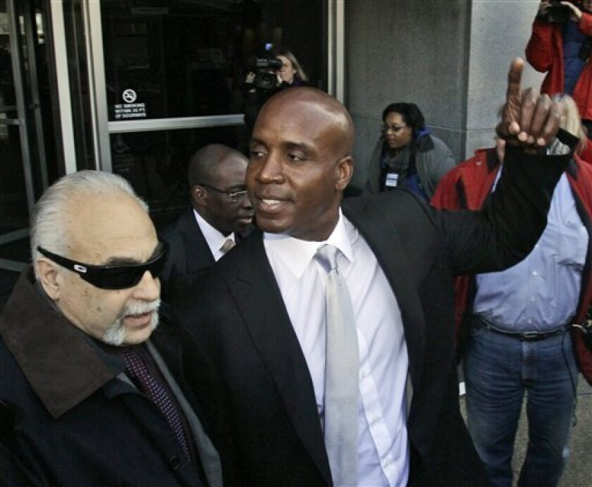 Barry Bonds, right, leaves the federal courthouse after the first day of his trial, Monday, March 21, 2011, in San Francisco. (AP Photo/Marcio Jose Sanchez)