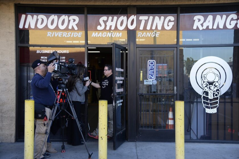 A news crew interviews an employee of the Riverside shooting range where FBI sources say Syed Farook practiced before going on a shooting rampage.
