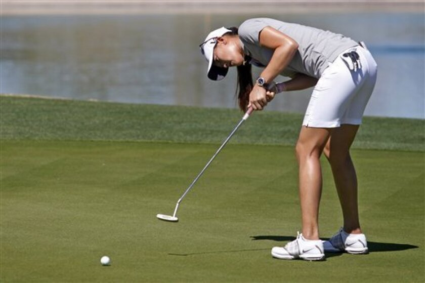 Michelle Wie putts on the eighth green during the first round of the Founders Cup golf tournament, Thursday, March 14, 2013, in Scottsdale, Ariz. (AP Photo/Paul Connors)