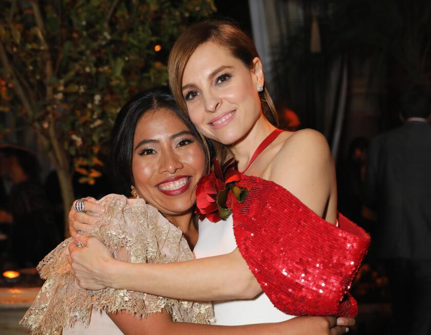 "HOLLYWOOD, CA - DECEMBER 10:  Yalitza Aparicio (L) and Marina de Tavira attend the Netflix ""Roma"" Premiere at the Egyptian Theatre on December 10, 2018 in Hollywood, California.  (Photo by Rachel Murray/Getty Images for Netflix)"