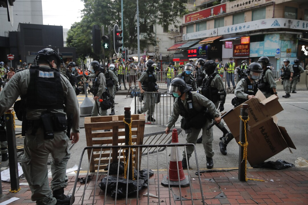 Riot police clear a road after pushing back security law protesters in Hong Kong on Wednesday.