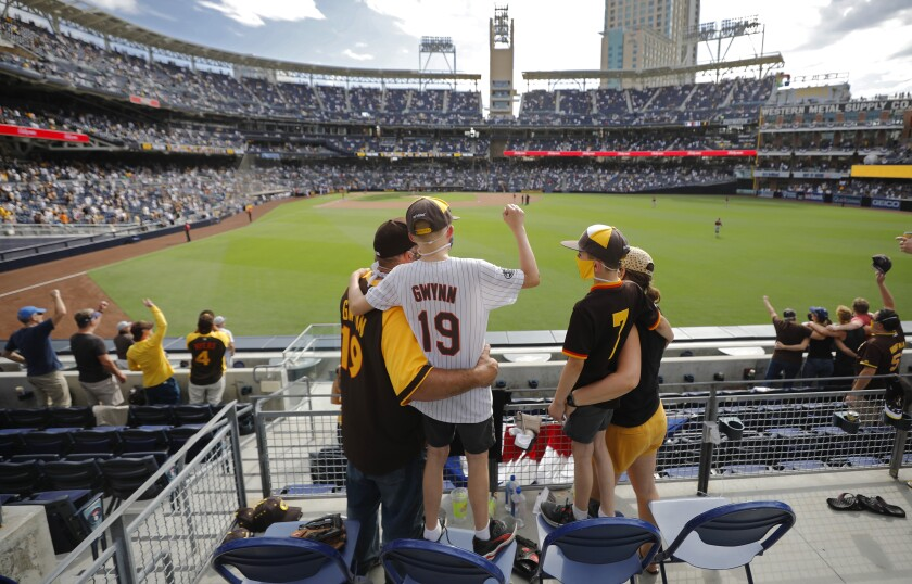 Fans attend Padres' opening day win Thursday against the Diamondbacks at Petco Park.