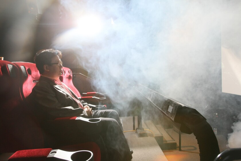 Theodore Kim, chief operating officer, LA LAB of CJ 4DPLEX, is photographed in Hollywood on June 7, 2012. He is surrounded by fog, one of many effects created by the companies 4DX system.