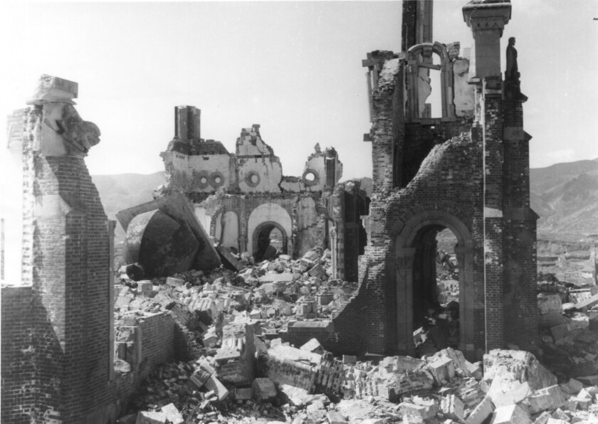 """Ruins of Urakami Church, ca, 1947. At center are the remains of the front inner wall and one of the two bell tower domes. Image from the book """"Nagasaki"""" by Susan Southard."""