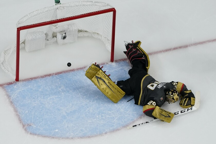 Vegas Golden Knights goaltender Marc-Andre Fleury (29) is scored on by Montreal Canadiens right wing Cole Caufield, not pictured, during the second period in Game 5 of an NHL hockey Stanley Cup semifinal playoff series Tuesday, June 22, 2021, in Las Vegas. (AP Photo/John Locher)