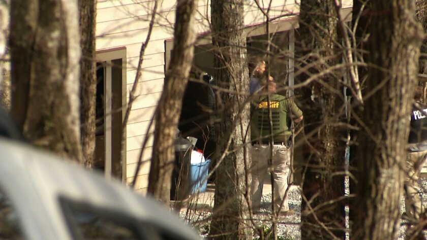 In this image taken from video, federal agents execute a search warrant at the Sapphire, N.C., home of Jose Lantigua on Monday, March 23, 2015. Lantigua, a Jacksonville businessman reported dead two years ago in Venezuela, was arrested in North Carolina on Saturday, March 21, on alleged fraud charg