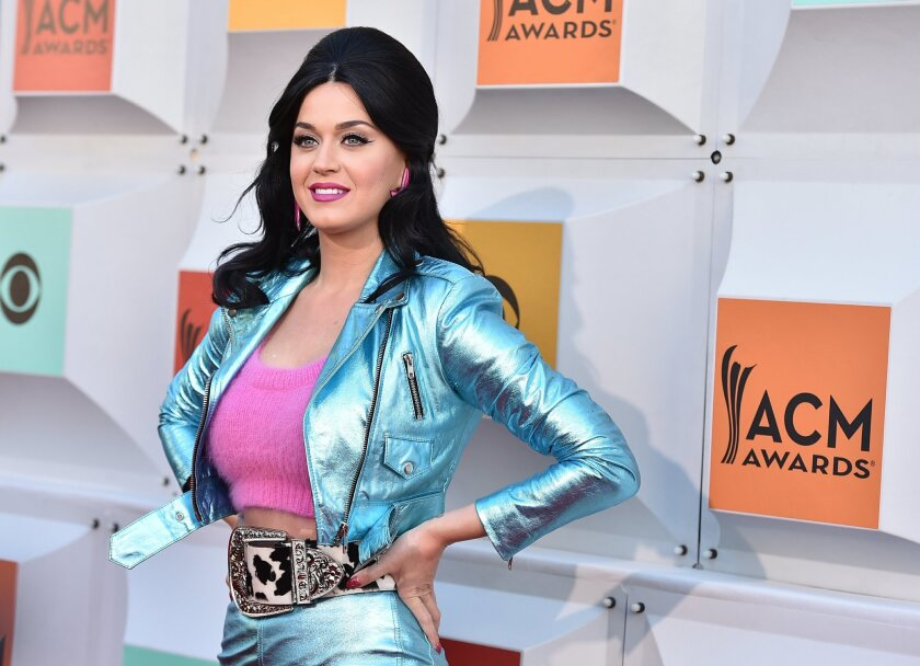 """FILE - In this April 3, 2016, file photo, Katy Perry arrives at the 51st annual Academy of Country Music Awards at the MGM Grand Garden Arena in Las Vegas. Perry released """"Rise"""" on July 14, 2016. The single marks her first new music since her 2013 album, """"Prism."""" (Photo by Jordan Strauss/Invision/A"""