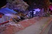 Hit and run driver arrested after crashing into yard