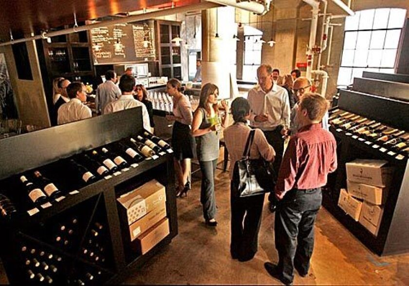 A wine-tasting group in the wine shop of Palate Food + Wine in Glendale, a restaurant, wine bar and wine shop.